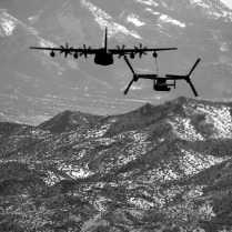 A 71st Special Operations Squadron, CV-22 Osprey, is refueled by a 522nd Special Operations Squadron MC-130J Combat Shadow II over the skies of New Mexico, Jan. 4, 2012. The 71st is stationed at Kirtland Air Force Base, N.M., and the 522nd SOS at Cannon Air Force Base, N.M. The MC-130J provided in-flight refueling as part of a joint-base partnership. (U.S. Air Force photo by Senior Airman James Bell)